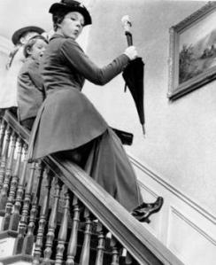 Mary Poppins sliding down the banister with the children full clothed and ready to go, first thing in the morning.